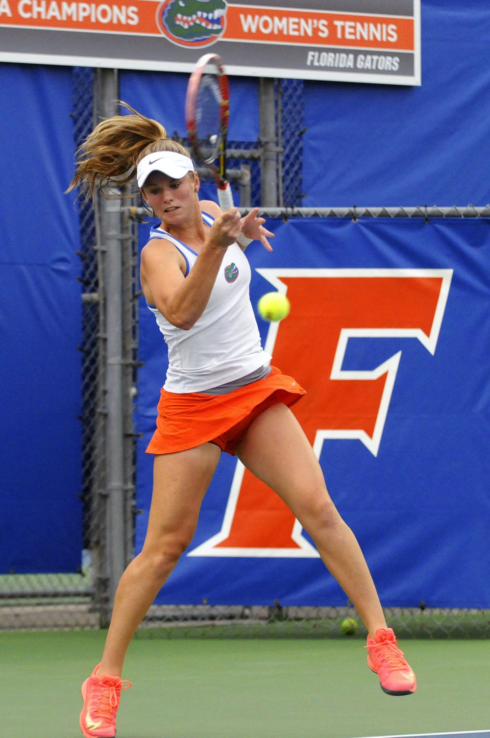 <p>Belinda Woolcock returns a ball during a ball during Florida's win against South Florida on Jan. 27 at the Ring Tennis Complex.</p>