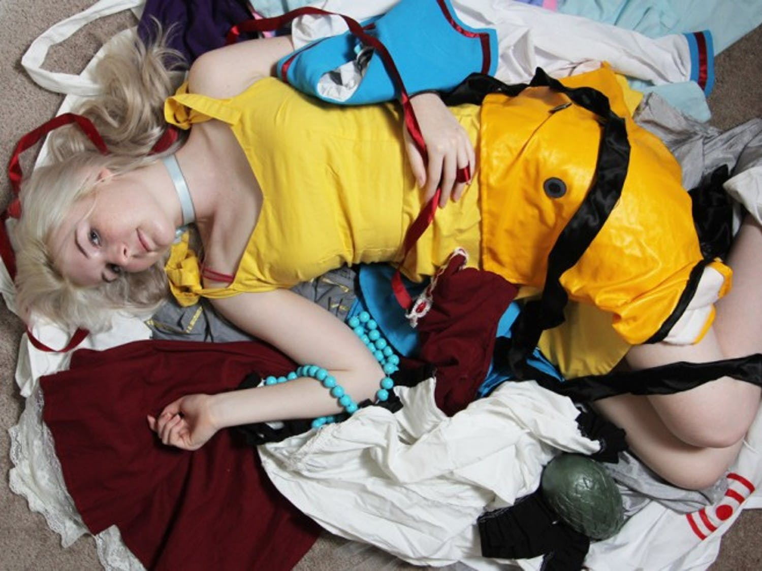Devan Baird, a 21-year-old telecommunication senior, lies on her competition-winning cosplays, which are costumes based on television, anime and comic book characters.
