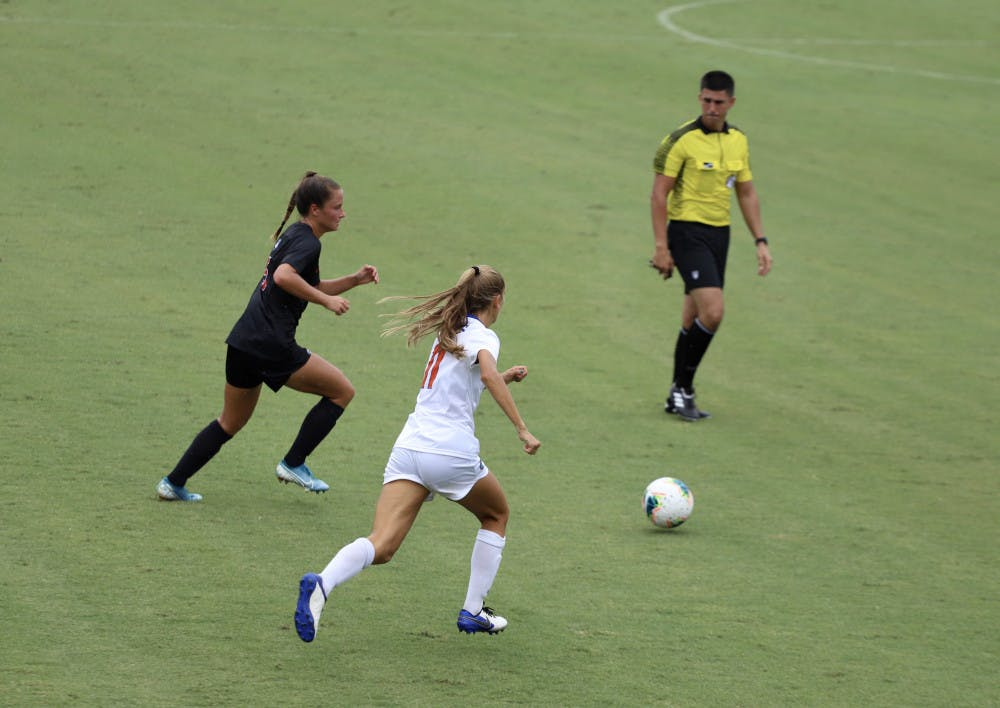 """<p><span id=""""docs-internal-guid-a05bbfc4-7fff-b410-1572-d9f42d1bc2e2""""><span>Redshirt freshman midfielder Nicole Vernis fights for a ball at Florida's home opener against Georgia this season. Vernis scored her first collegiate goal versus South Carolina Sunday afternoon.</span></span></p>"""