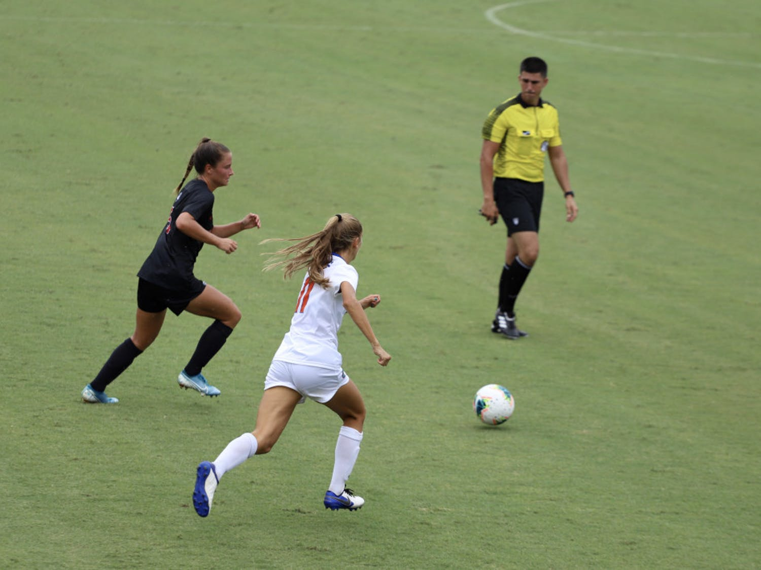 Redshirt freshman midfielder Nicole Vernis fights for a ball at Florida's home opener against Georgia this season. Vernis scored her first collegiate goal versus South Carolina Sunday afternoon.