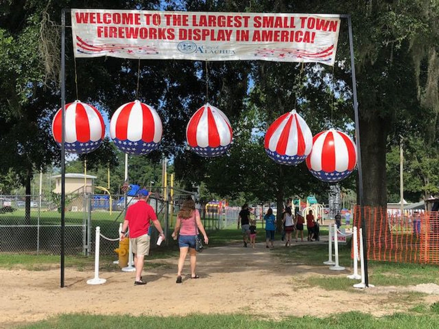 People file in through the main entrance to attend the festival.
