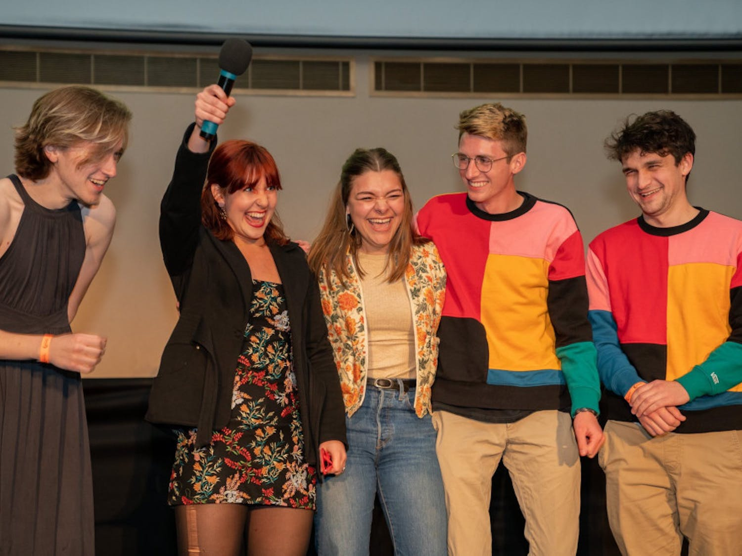 """Natalie Canellas accepts a jury award for her short film """"The Perfect Playlist"""" alongside her casta nd crew."""