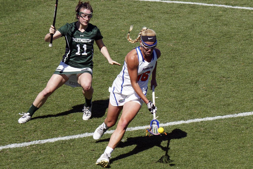<p>UF's Nicole Graziano (right) makes a play on the ball during Florida's 16-6 win over Dartmouth on Feb. 27, 2016.&nbsp;</p>