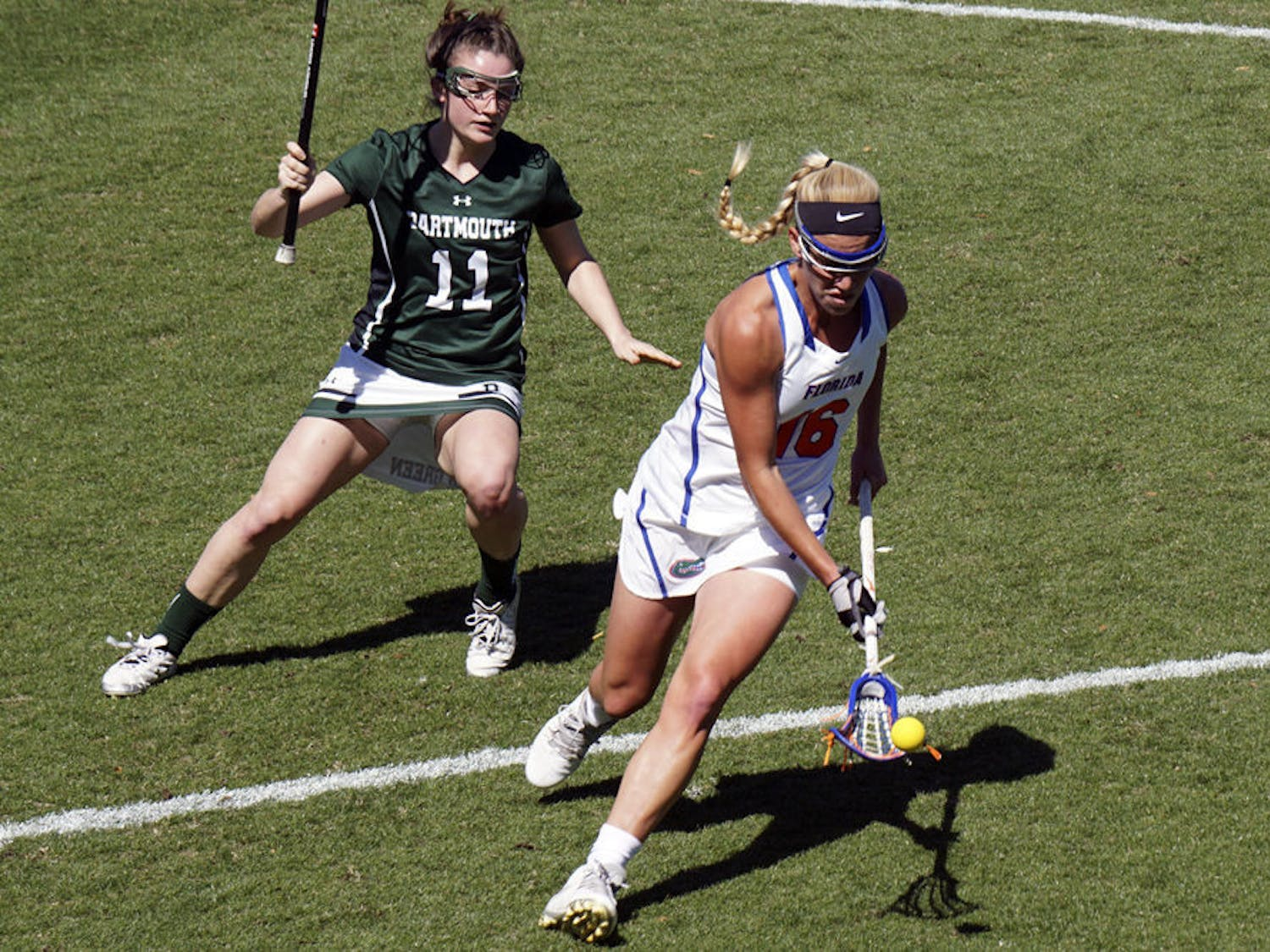 UF's Nicole Graziano (right) makes a play on the ball during Florida's 16-6 win over Dartmouth on Feb. 27, 2016.