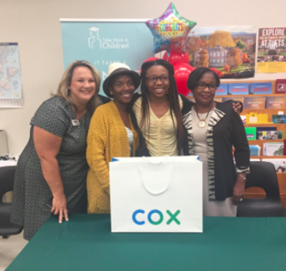<p><em>Former Superintendent Karen Clarke, left, Moore's mom, Tedreyonce&#x27; Moore and Deputy Superintendent Donna Jones smile on Oct. 28, 2019, the day Moore received her laptop. Clarke and Jones were Moore's mentors. (Courtesy of The Education Foundation of Alachua County)</em></p>
