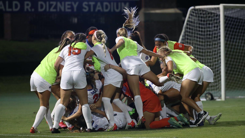 Florida soccer dogpiles on Julianne Leskauskas in celebration of its win over Kentucky on Thursday.