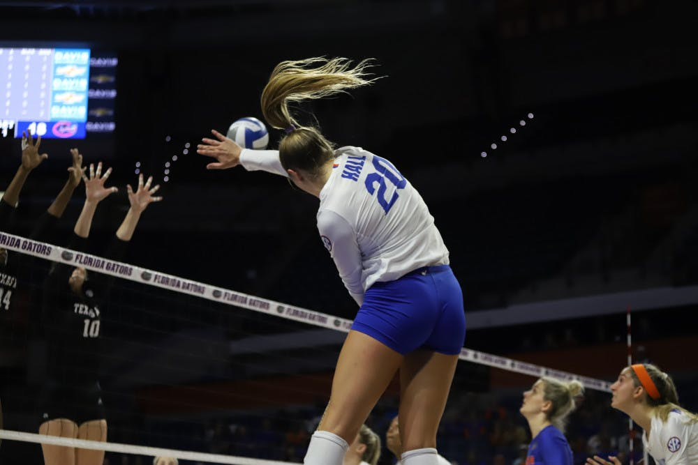 <p>Thayer Hall spikes the ball at Florida's game against Kentucky last season. On Friday night, Hall recorded 19 kills in the Gators' victory over Alabama.</p>
