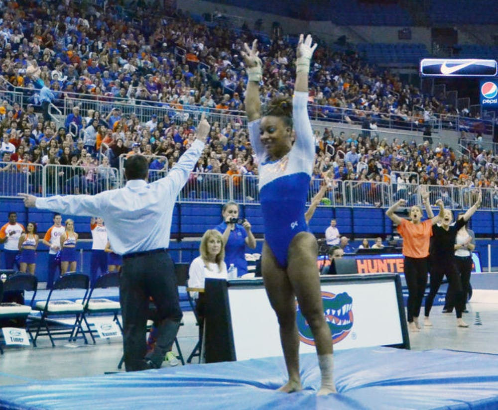 <p>Kytra Hunter performs a vault routine during Florida's 197.525-196.025 win against Arkansas on Feb. 14 in the O'Connell Center.</p>
