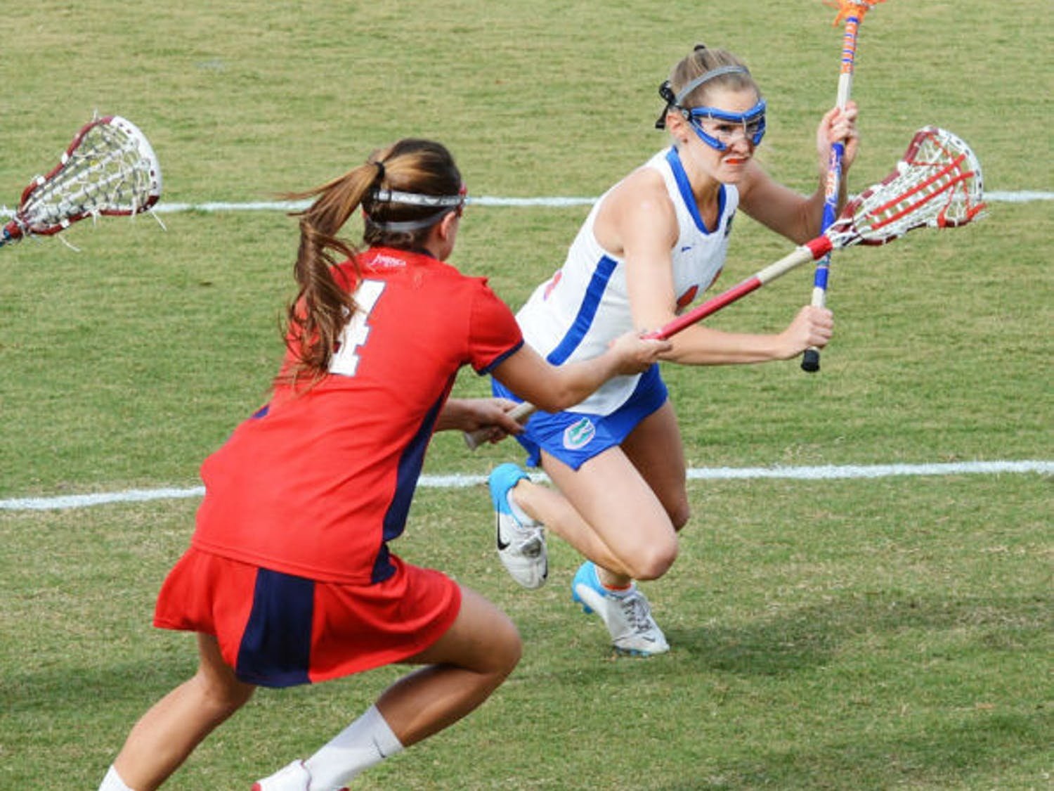 Sophomore midfielder Nora Barry runs past Stony Brook's Amber Kupres during the Gators' 16-9 win on Feb. 20 at Dizney Stadium. Barry scored three goals in Florida's 22-1 win against Stetson on Tuesday.