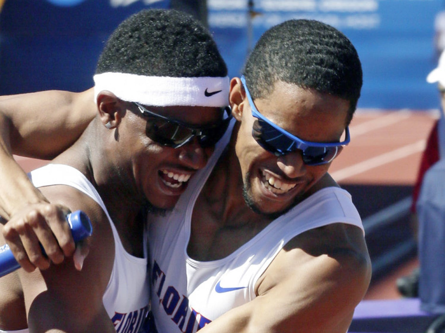Hugh Graham Jr. (left) hugs Arman Hall after winning the 4x400m relay during the NCAA outdoor championships in Eugene, Ore., on Saturday.