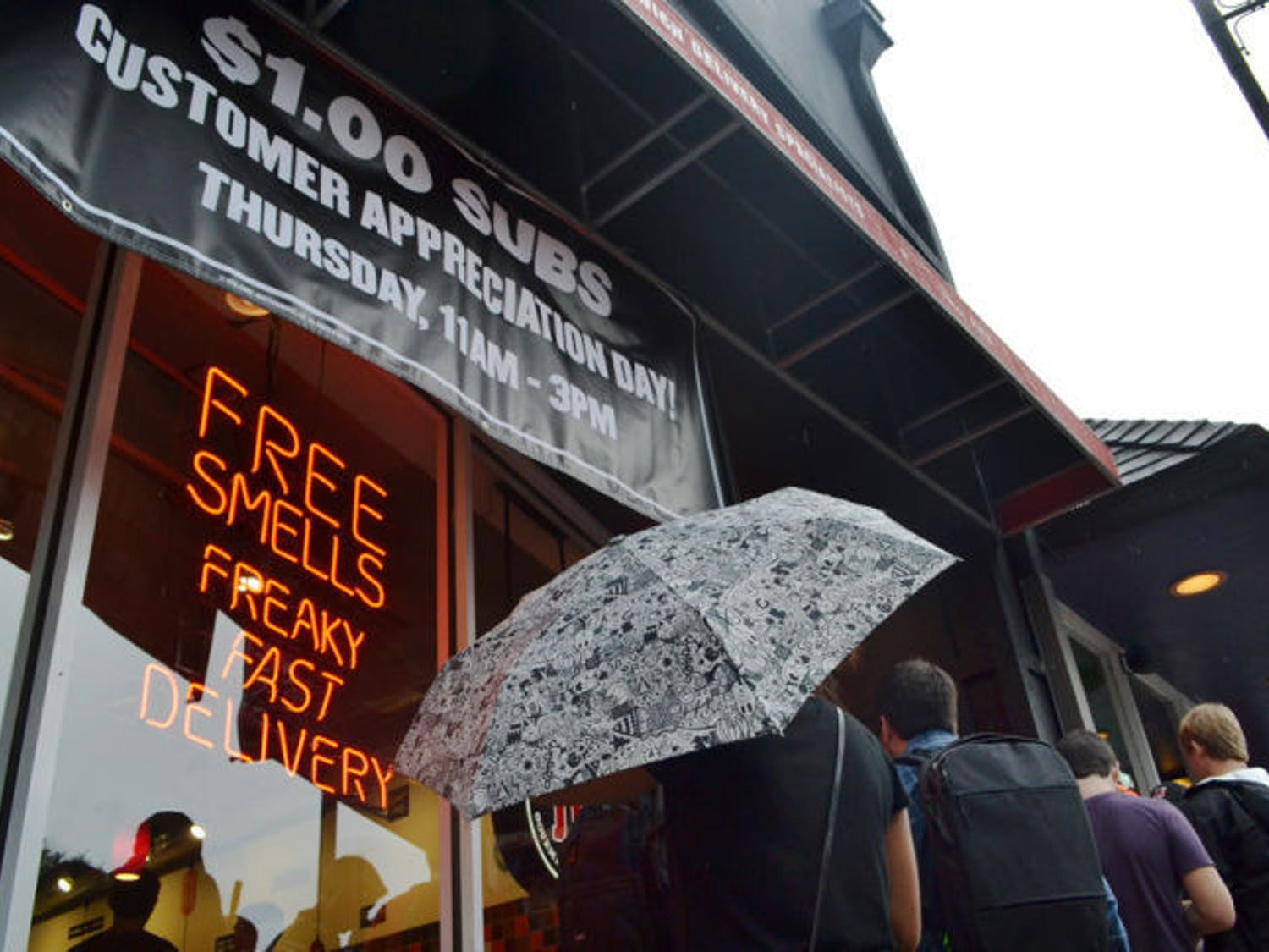 The rain didn't stop students from gathering around Midtown's Jimmy John's Gourmet Sandwiches location Thursday for Customer Appreciation Day. Until 3 p.m., the restaurant was selling the first six menu items for $1.