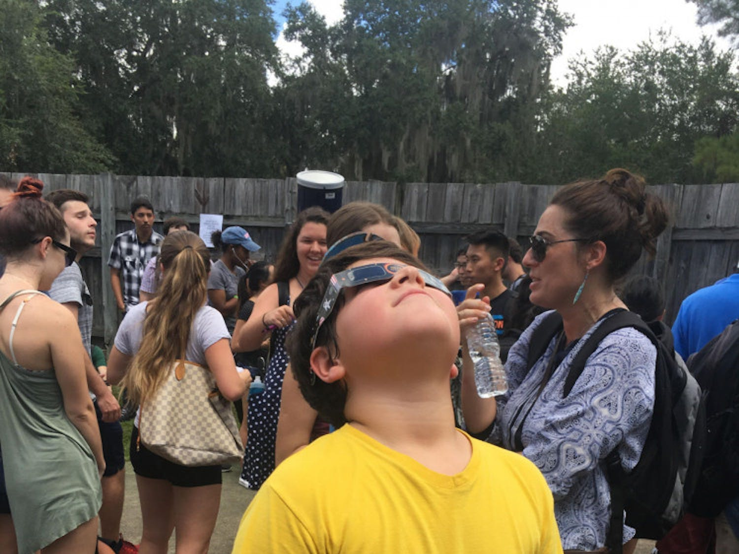 Nine-year-old Ian Sousa looks up at the eclipse with solar eclipse glasses. He was one of thousands who attended a viewing atUF Campus Teaching Observatory.