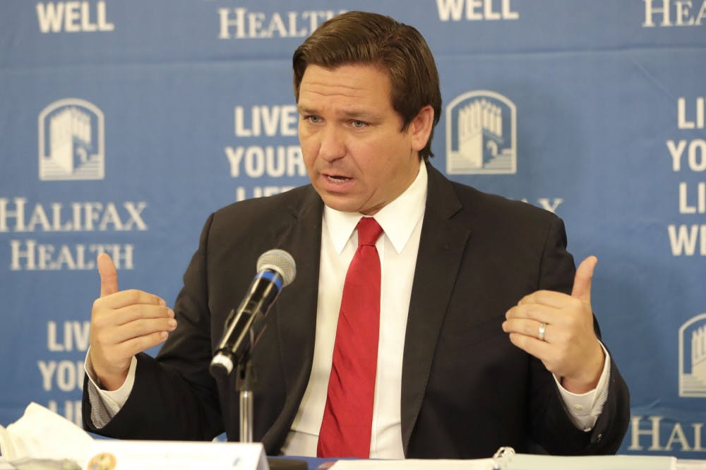 <p>Florida Gov. Ron DeSantis speaks at a news conference at Halifax Health Medical Center Sunday, May 3, 2020, in Daytona Beach, Fla. Business owners across much of Florida were busy Sunday preparing to reopen Monday under new restrictions. Gov. Ron DeSantis said he's deliberately taking things slowly during re-opening. (AP Photo/John Raoux)</p>