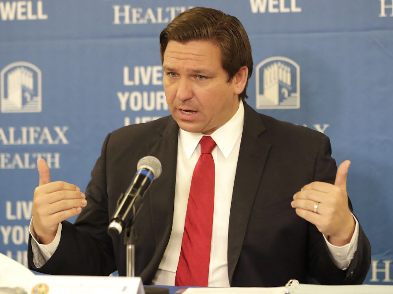 Florida Gov. Ron DeSantis speaks at a news conference at Halifax Health Medical Center Sunday, May 3, 2020, in Daytona Beach, Fla. Business owners across much of Florida were busy Sunday preparing to reopen Monday under new restrictions. Gov. Ron DeSantis said he's deliberately taking things slowly during re-opening. (AP Photo/John Raoux)