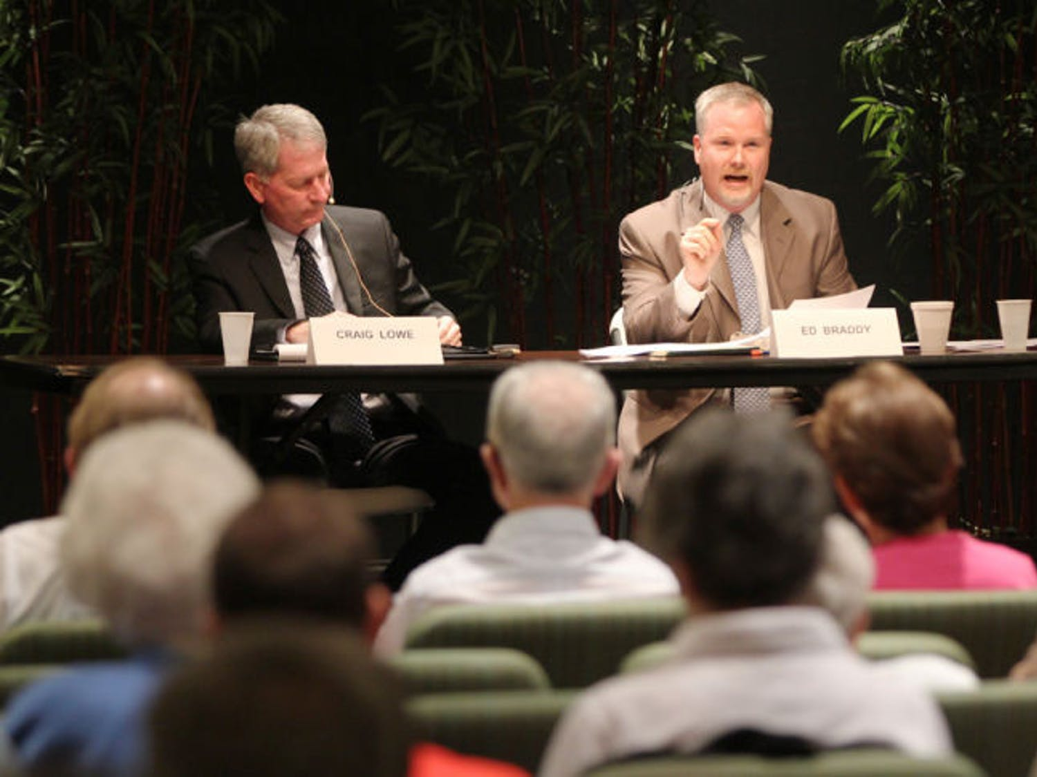 Mayor Craig Lowe and mayoral candidate Ed Braddy debate at Oak Hammock at UF retirement community Tuesday night. About 90 people attended.