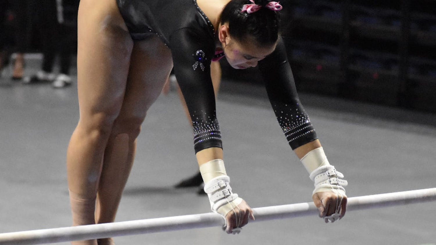 Freshman Ellie Lazzari performs on the bars against Kentucky Feb. 19