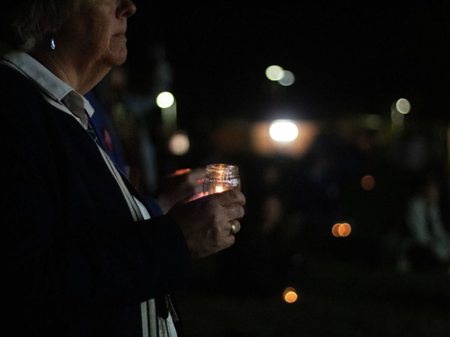 Flo Turcotte holds a candle for the vigil during the Transgender Day of Remembrance at Depot Park Wednesday night.