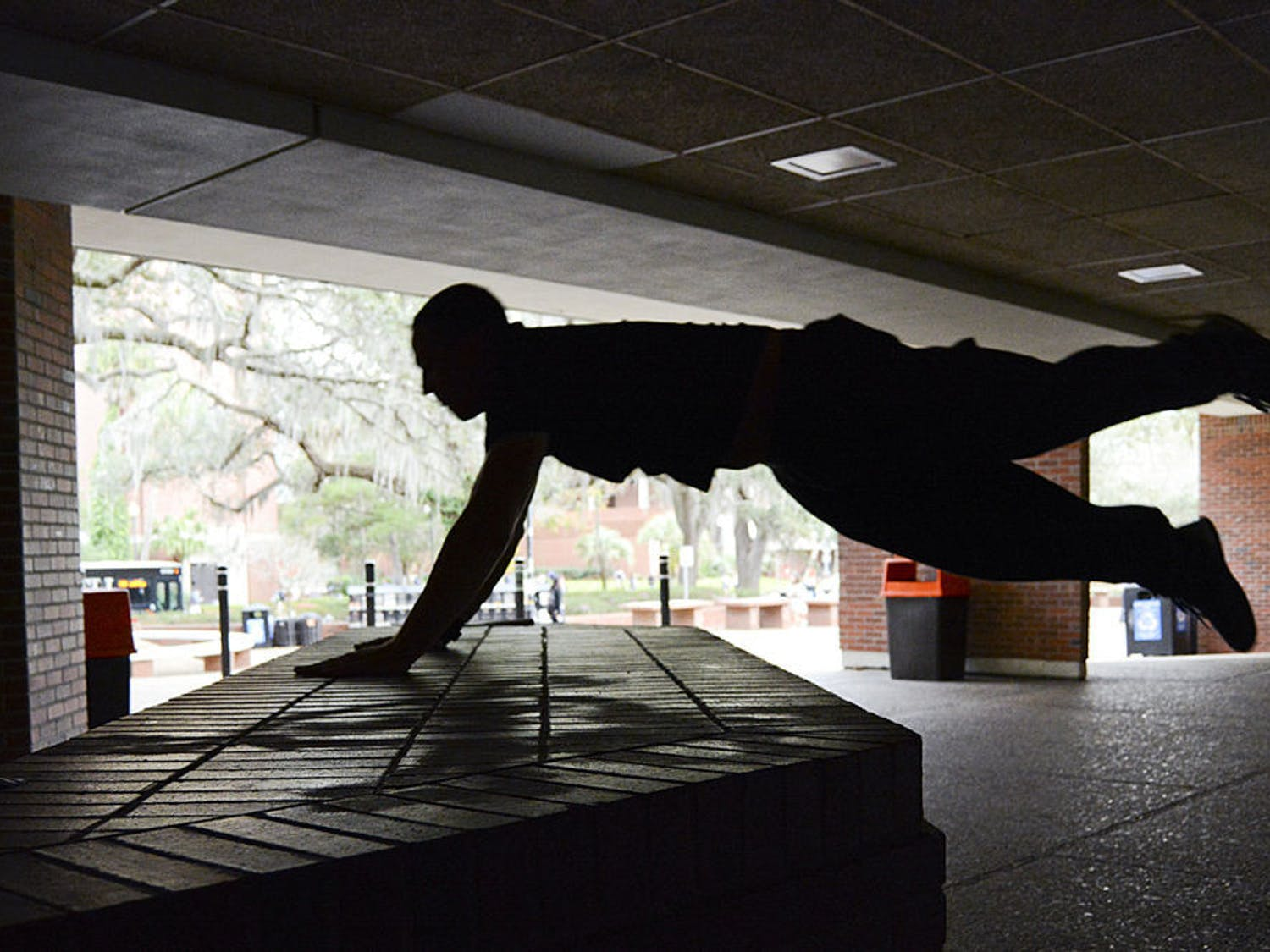 A pair of friends and parkour veterans explore and vault across campus.