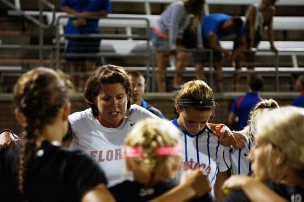 <p>Gators coach Becky Burleigh consoles her team in 2015 after a 2-1 loss at the hands of Texas A&amp;M. Burleigh has been at the helm for Florida since 1995.</p>