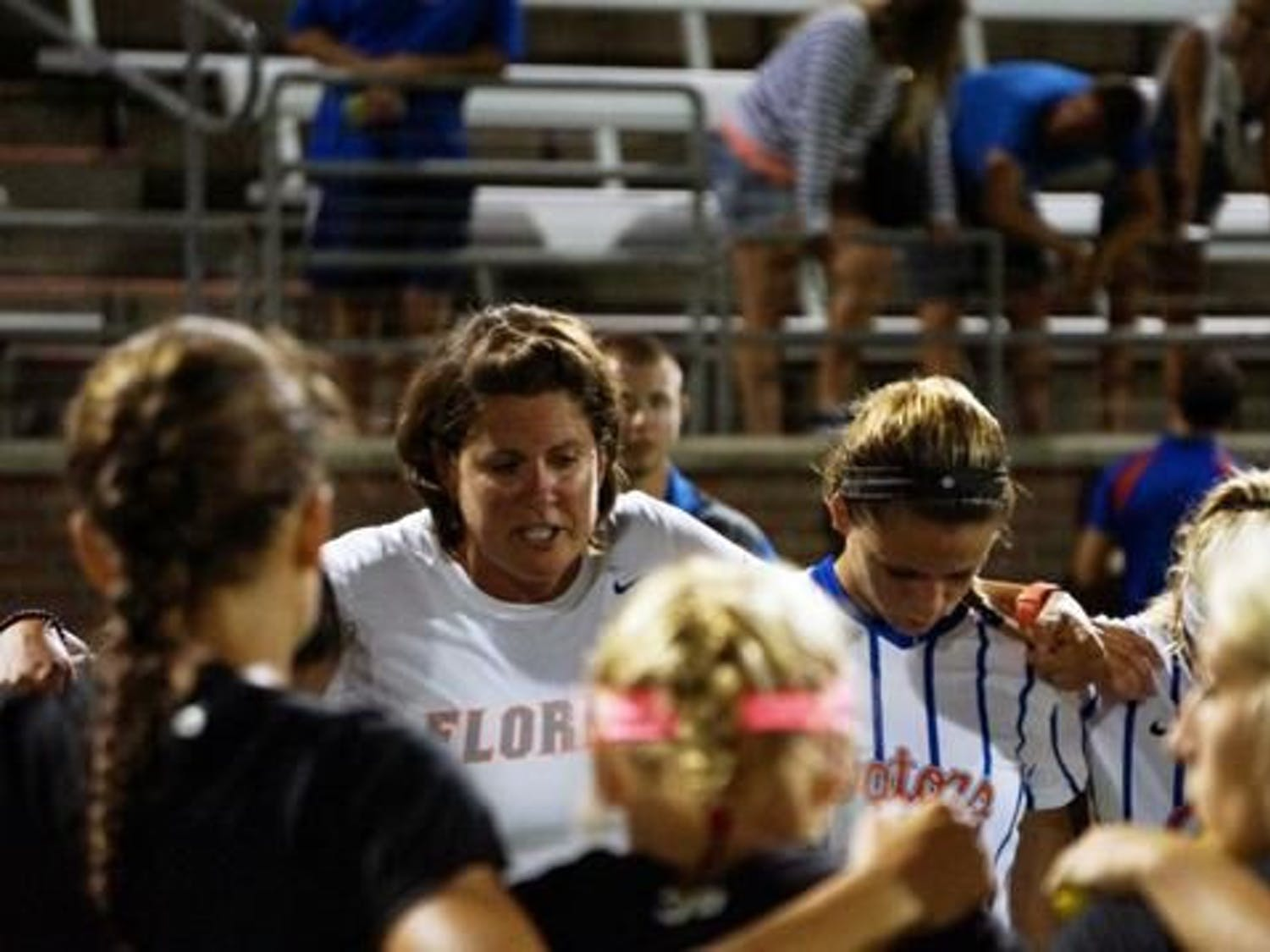 Gators coach Becky Burleigh consoles her team in 2015 after a 2-1 loss at the hands of Texas A&M. Burleigh has been at the helm for Florida since 1995.