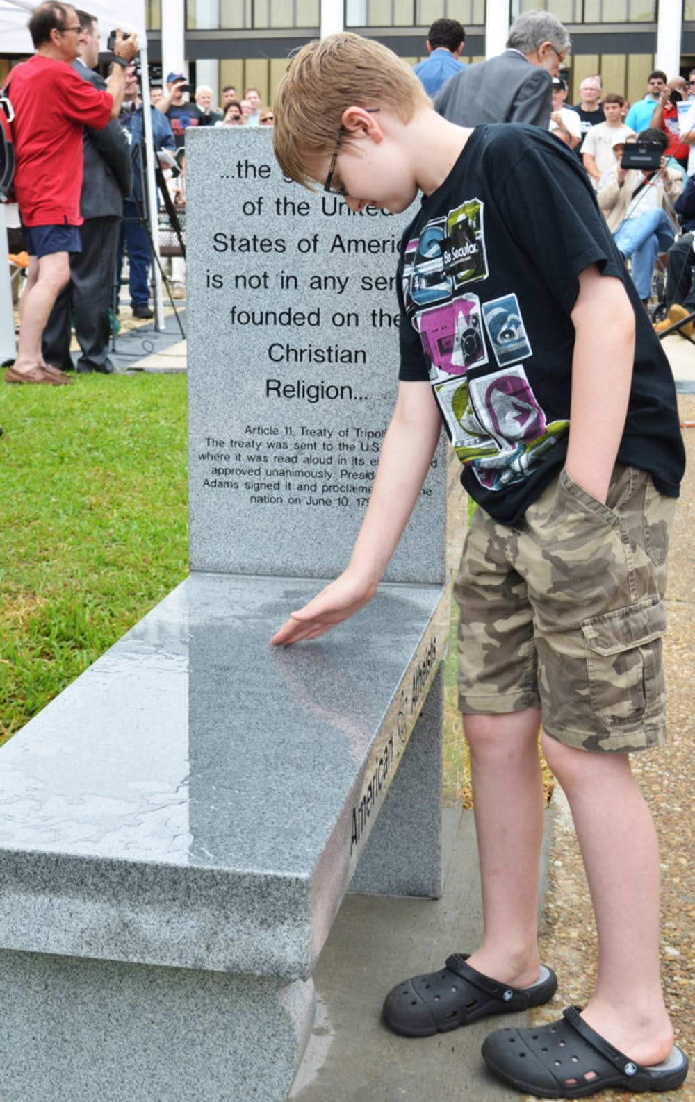 <p>Chandler Allen, 10, of Orlando, was the first to sit on the newly revealed atheist monument outside the Bradford County Courthouse.</p><div> </div>