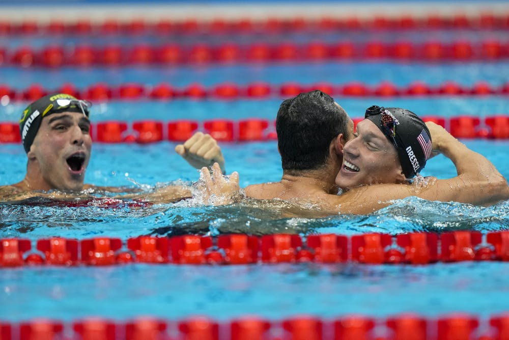 Caeleb Dressel, of United States, celebrates after winning the gold medal in a men's 50-meter freestyle fiat the 2020 Summer Olympics, Sunday, Aug. 1, 2021, in Tokyo, Japan. At left Bruno Fratus, of Brazil, celebrates winning the bronze medal. (AP Photo/David Goldman)
