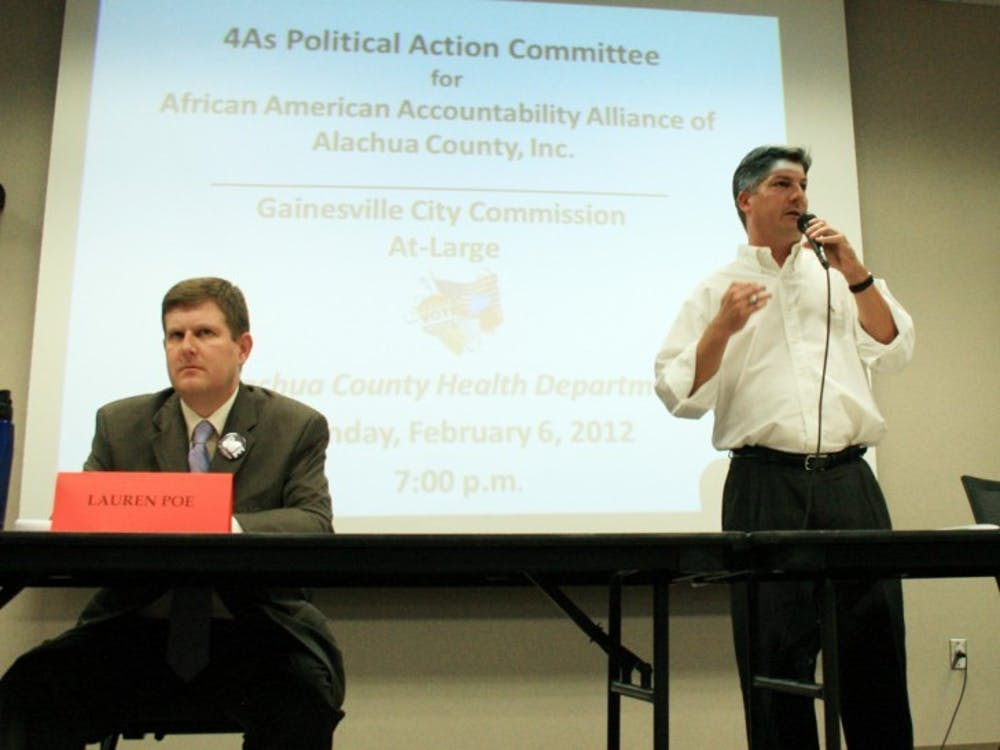<p>Lauren Poe and Nathan Skop, Gainesville City Commission at-large 1 candidates, answer questions posed by the African American Accountability Alliance of Alachua County at the Alachua County Health Department on Monday night.</p>