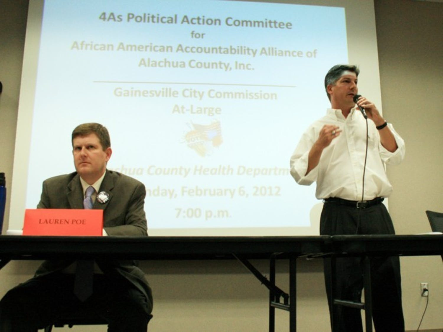 Lauren Poe and Nathan Skop, Gainesville City Commission at-large 1 candidates, answer questions posed by the African American Accountability Alliance of Alachua County at the Alachua County Health Department on Monday night.