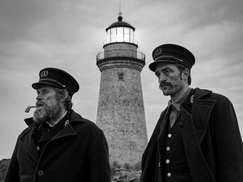 "Williem Dafoe and Robert Pattinson in director Robert Eggers ""The Lighthouse."""