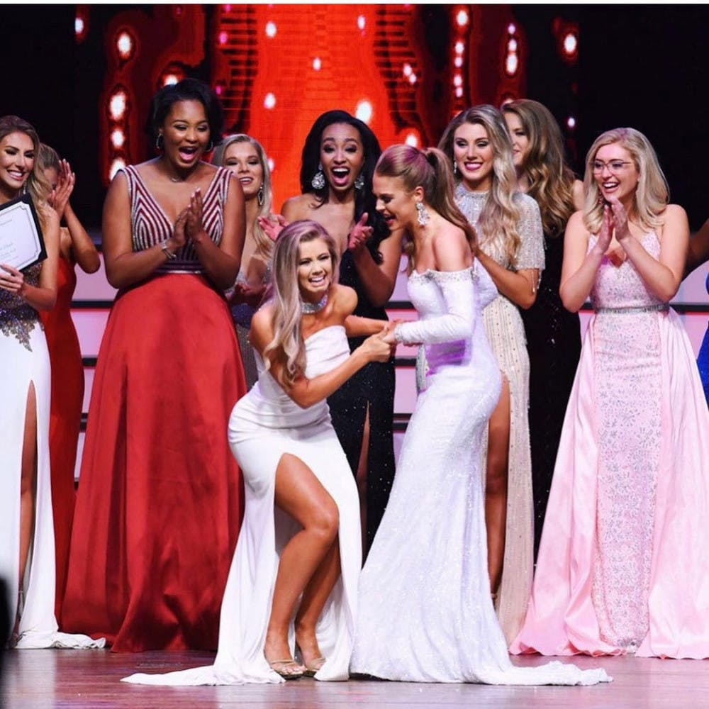<p><span>Leah Roddenberry (right in white) congratulating the winner of Miss Florida.</span></p>