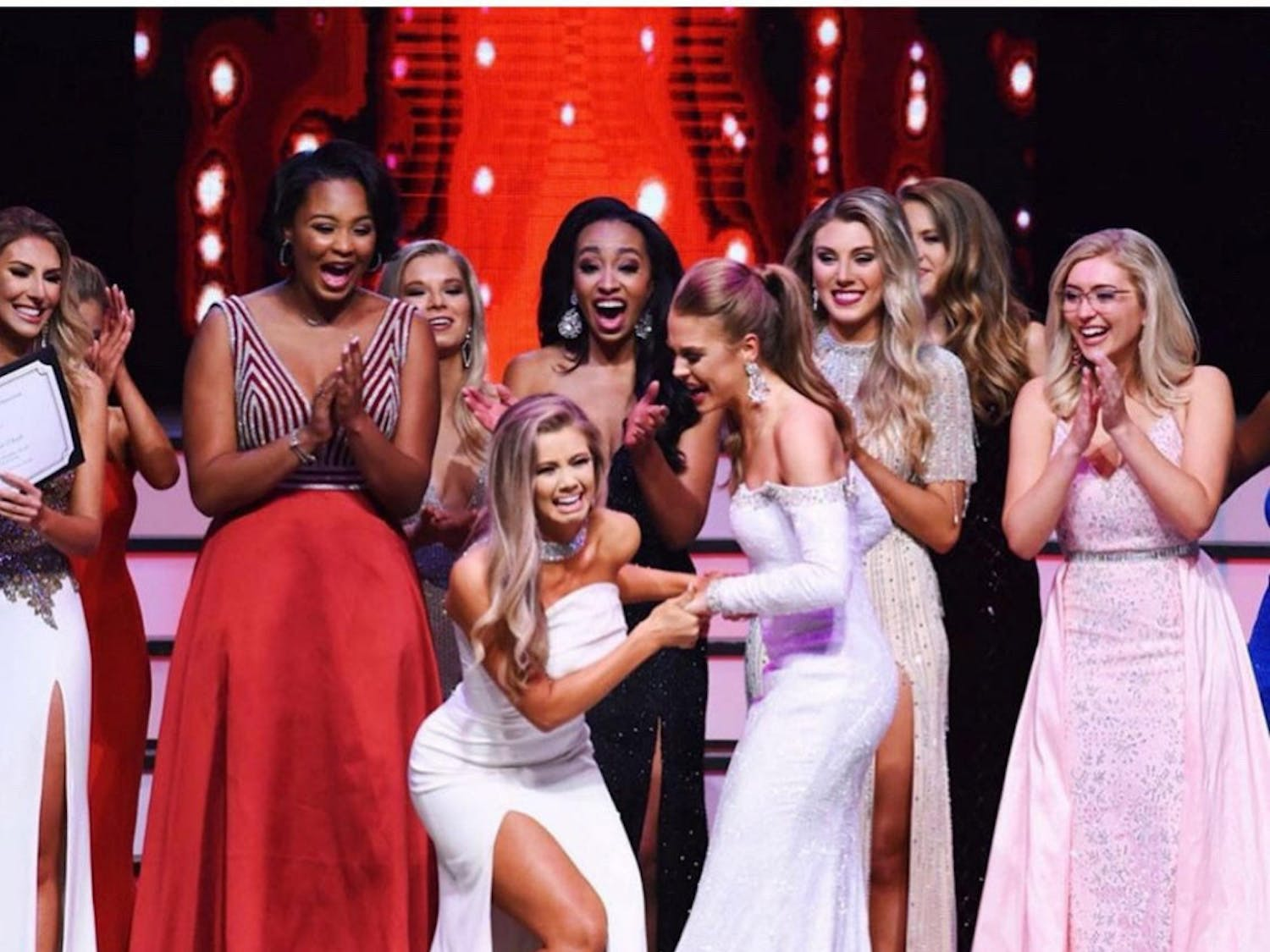 Leah Roddenberry (right in white) congratulating the winner of Miss Florida.