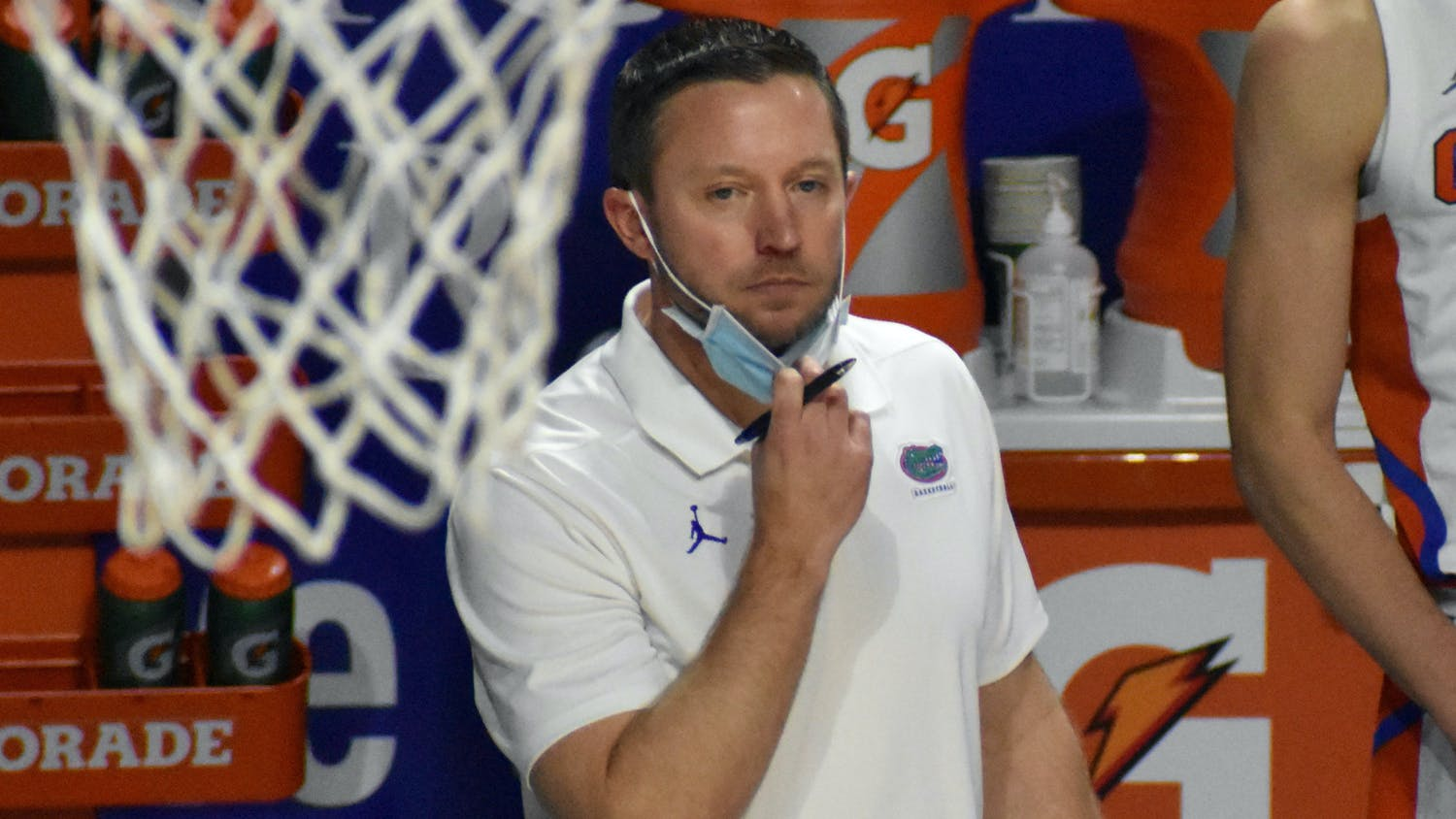 Coach Mike White stands on the sidelines at the O'Connell Center against Georgia Feb. 20. White and the Gators lost against Oral Roberts 81-78 in the second round of the NCAA Tournament Sunday.
