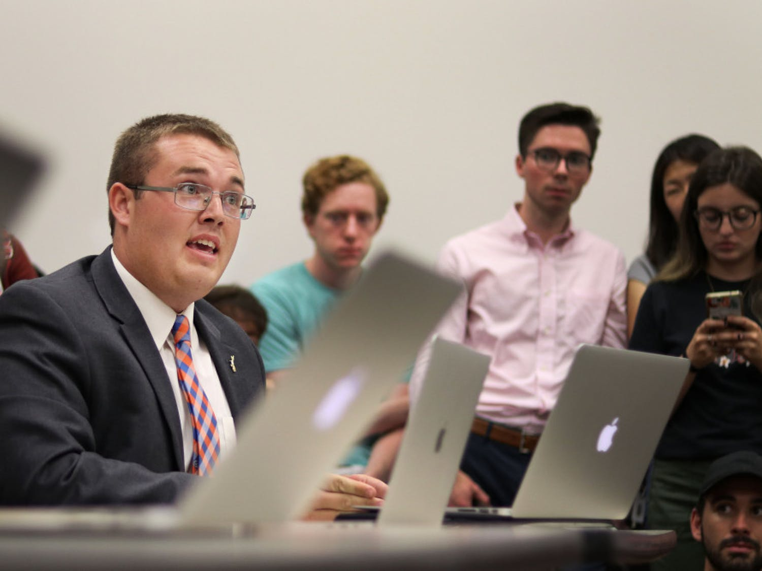 Branden Pearson speaks in defense of Gator Party against allegations of campaign violations Thursday evening at a Student Government Elections Commission meeting at the Levin College of Law. The meeting followed a contentious Senate race between Gator Party and Inspire Party.