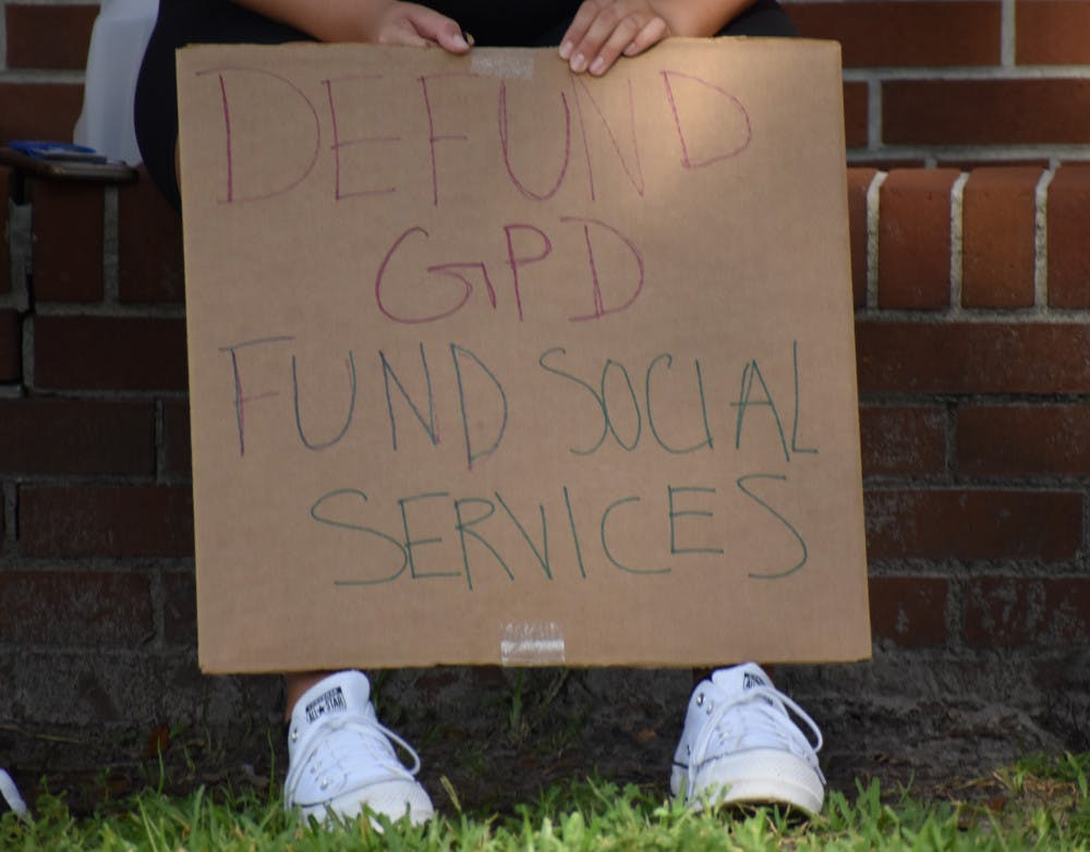 <p>More than 70 people gathered Sept. 3 to protest Gainesville City Commission's proposed increase to GPD's budget.</p>