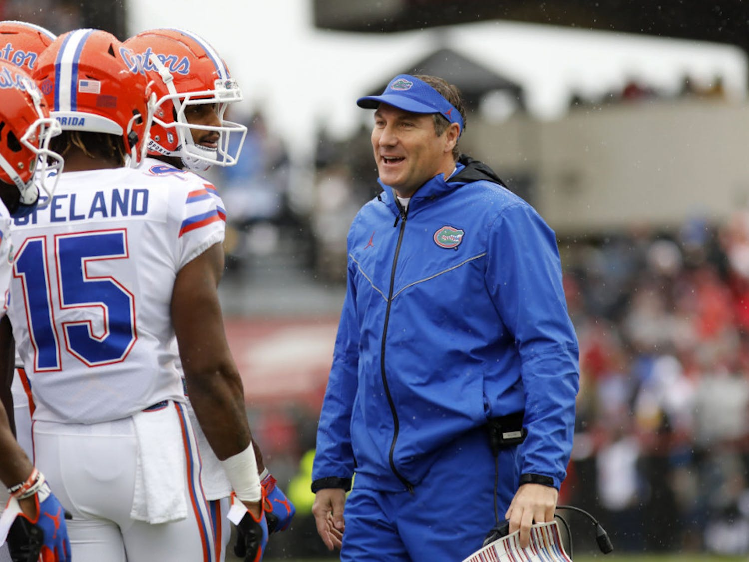 Florida's head coach Dan Mullen smiles with his players during the first half of an NCAA college football game against South Carolina, Saturday, Oct. 19, 2019, in Columbia, SC.