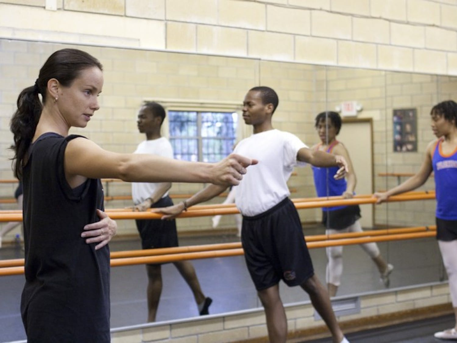 Reka Gyulai, 25, a ballet instructor at Pofahl Studios, 1325 NW Second St., teaches the night class July 9