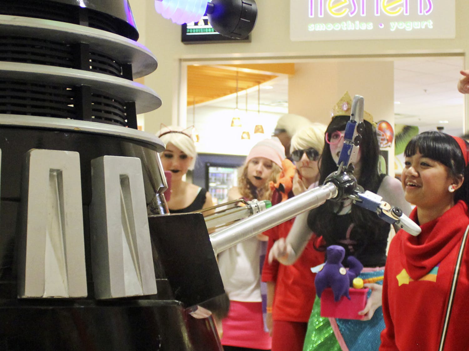 A Dalek, a creature from the British television program Doctor Who, roams through the Reitz Union on Saturday during SwampCon. The convention was attended by people dressed up as characters from different fictional series.