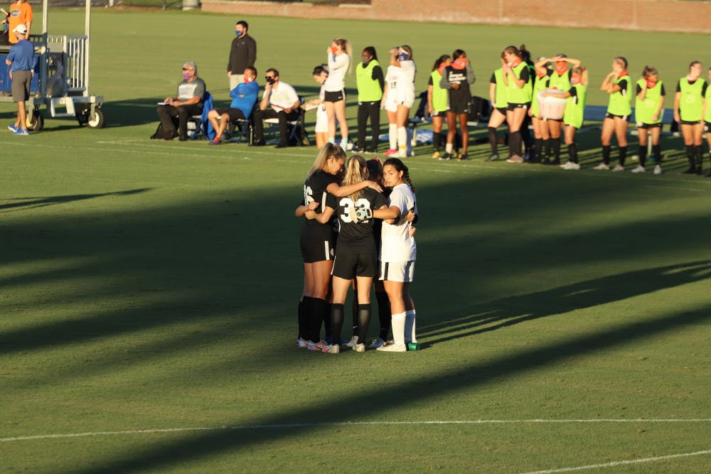 <p>Gators stand in a huddle in their final home game of the 2020 season. Florida will play two road games this weekend against SEC opponents Kentucky and Missouri.</p>