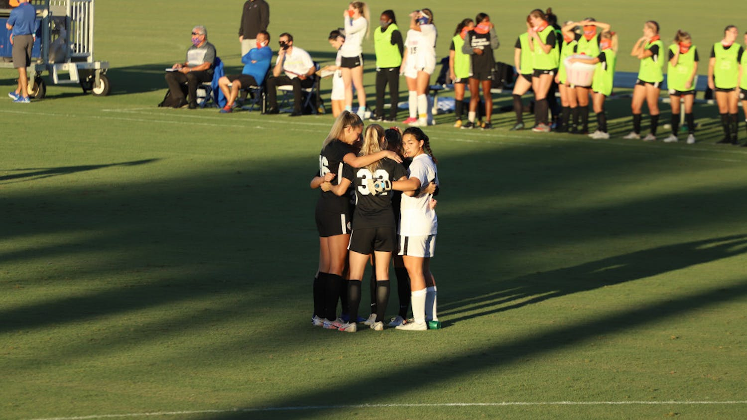 Gators stand in a huddle in their final home game of the 2020 season. Florida will play two road games this weekend against SEC opponents Kentucky and Missouri.