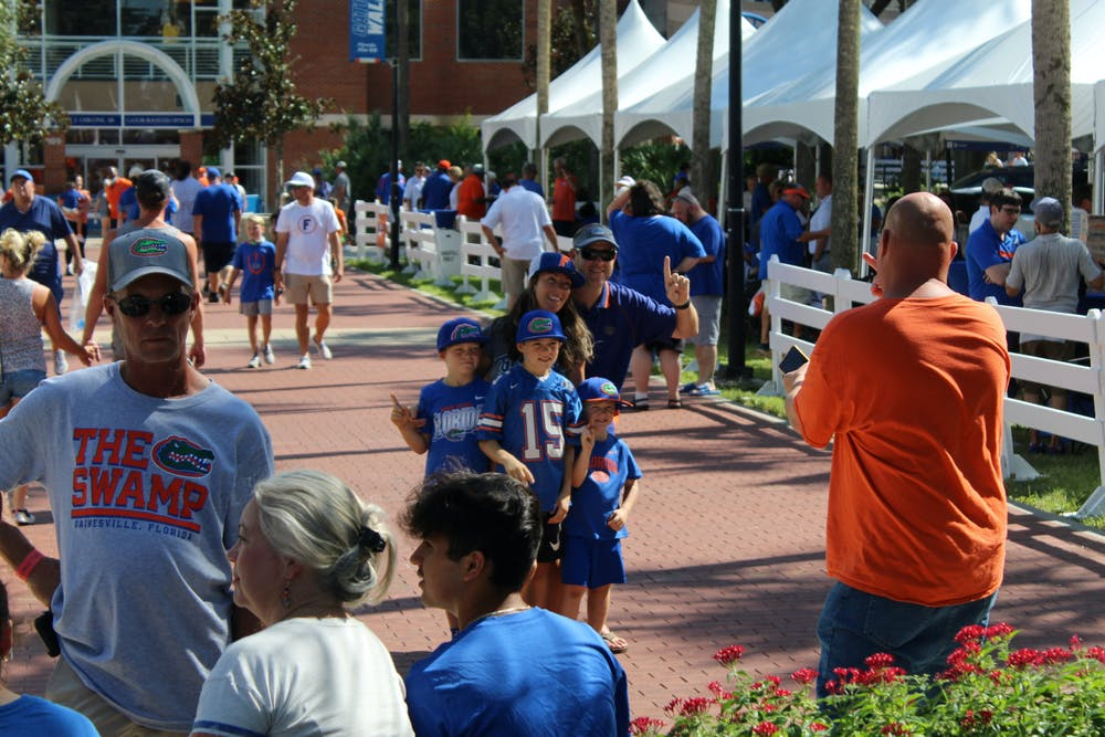 A family of Florida fans takes a picture during a pre-game tailgate in front of Ben Hill Griffin Stadium on Sept. 4.