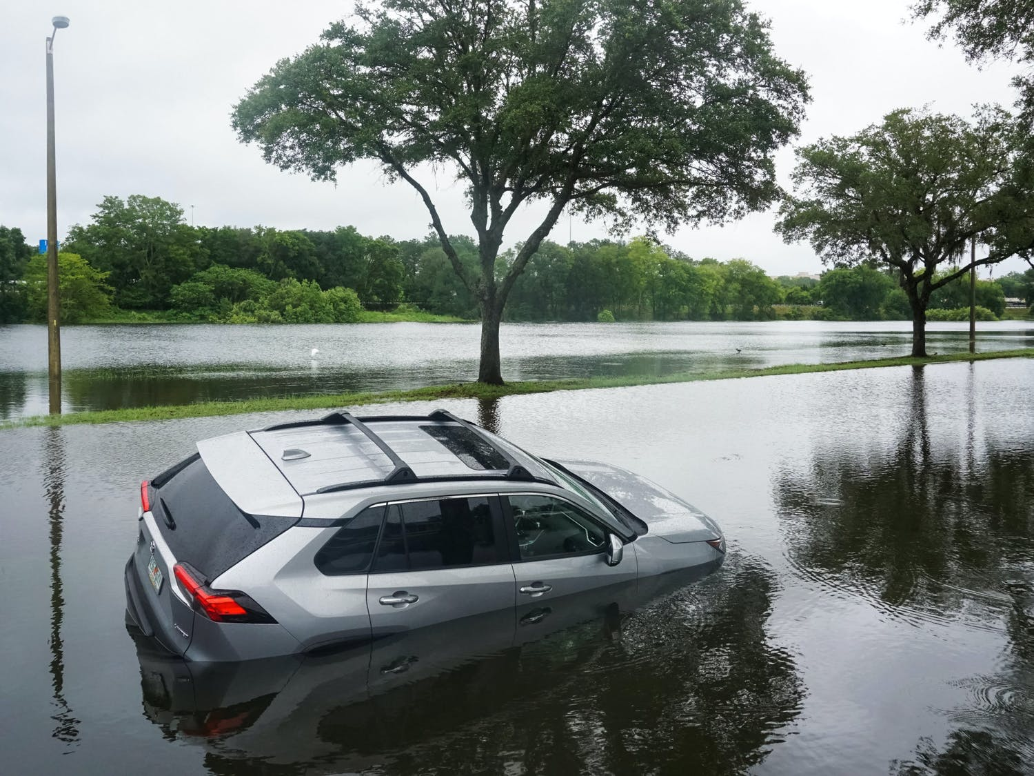 A deserted Toyota RAV-4 on Northwest Fourth Boulevard in Gainesville on Wednesday, July 7, 2021. The Gainesville Police Department stated this vehicle and one other got stuck after drivers attempted to cross the flooded street.
