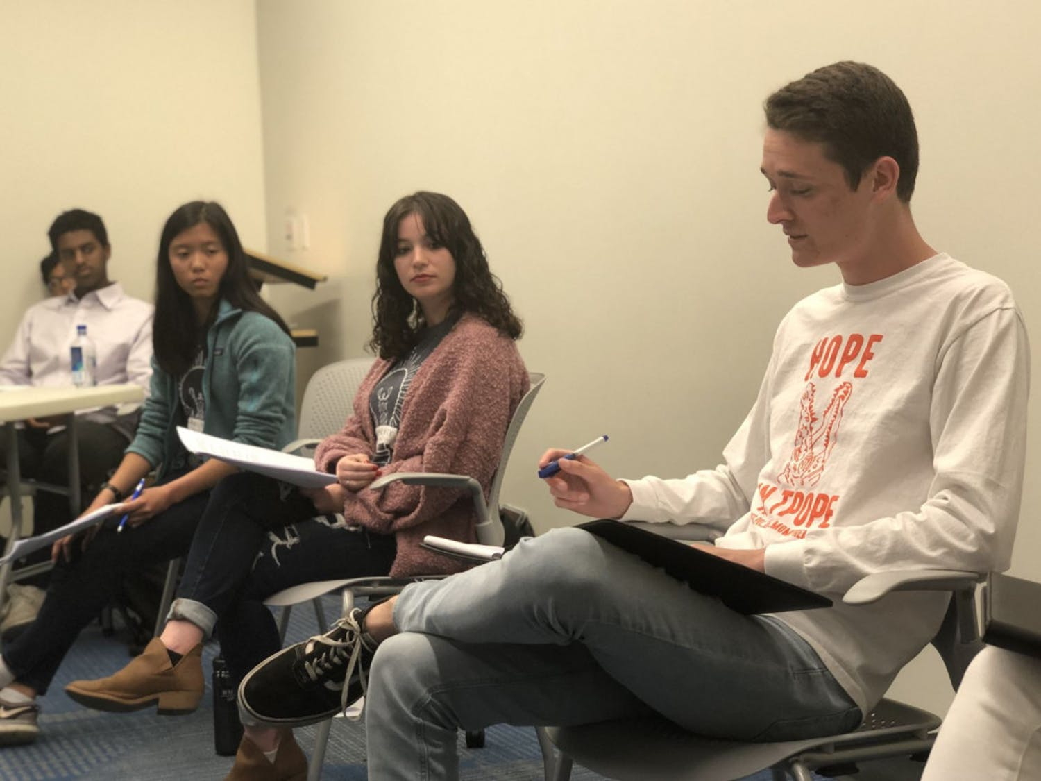 Candidates Emma Sanchez (left), Zoe Terner (middle) and Nick Meyer (right) deliver their closing remarks at a debate between Inspire and Gator parties' liberal arts and sciences candidates on Monday night.