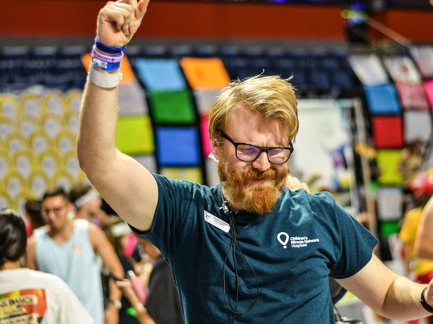 Andrew Jensen, the Overall Director of Dance Marathon 2019, rocks out during the Savants of Soul's performance Saturday night in the O'Connell Center. Dance Marathon lasted for 26.2 hours and raised $3,230,025.23 for children at UF Health Shands Children's Hospital and Children's Miracle Network.
