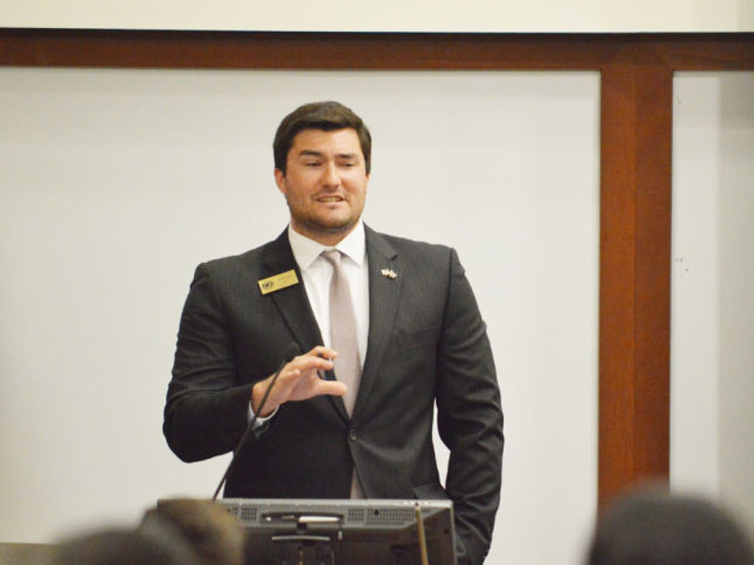 Sen. Davis Bean, chairman of the budget and appropriations committee, discusses the 2014-2015 Student Government-funded organizational budget during Tuesday's Student Senate meeting.