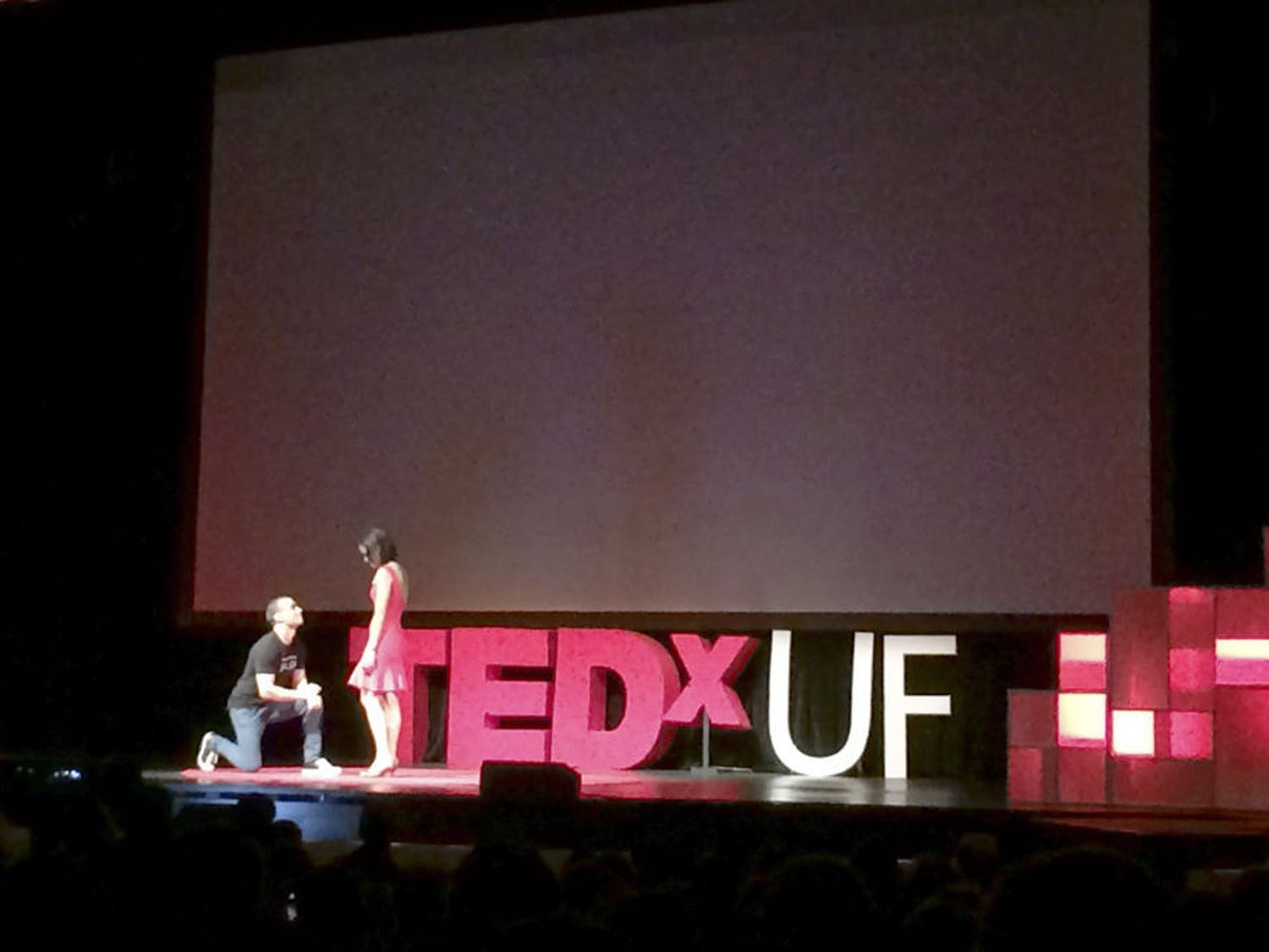 """Rob Castellucci, co-founder of RoomSync and founder of the Gator Salsa Club, proposes to his girlfriend after the end of his talk at TEDxUF on Saturday. """"I would go on for a thousand more reasons, but I'm pretty sure my 18 minutes is almost up,"""" Castellucci said. """"Will you marry me?"""""""