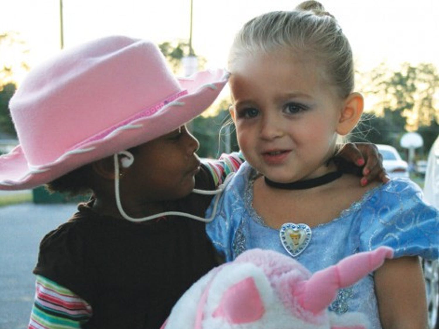 Two-year-old Farrah, right, and Davis spend Halloween together with Williams, Davis' adopted father, and his mother. Farrah and Davis are cousins, but Williams said they are growing up like sisters.