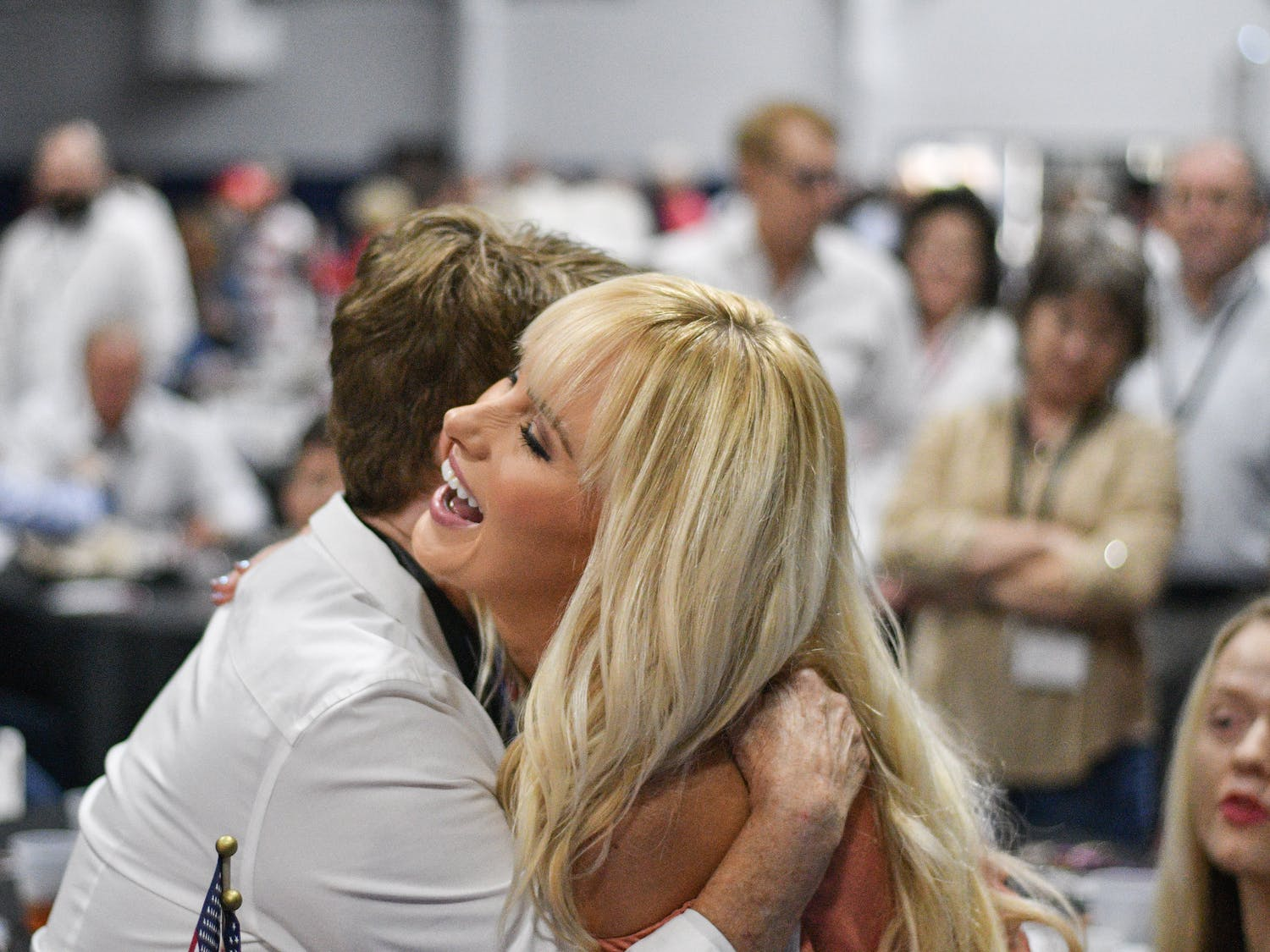 Tomi Lahren, a contributor for Fox News, hugs Ellen Ault, a member of the Alachua County Republican Party, Thursday night at the 16th Annual Ronald Reagan Black Tie and Blue Jeans Barbecue. Lahren was the keynote speaker at the sold-out event put on by the Alachua County Republican Party in Legacy Park.