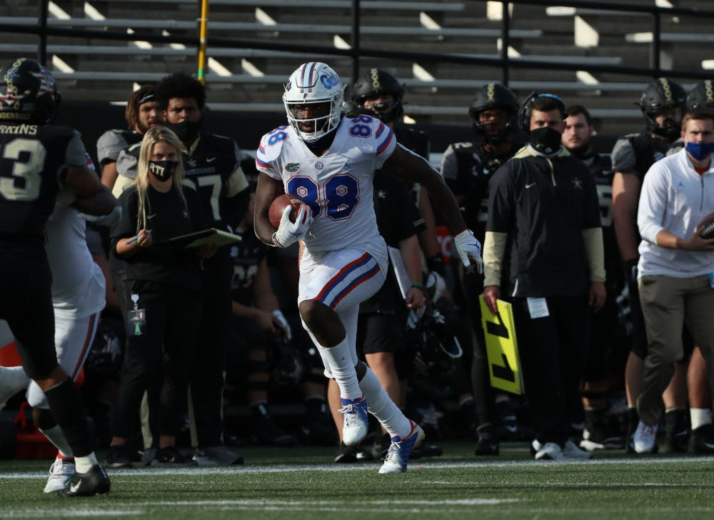 """<p>Tight end<span id=""""docs-internal-guid-ae8ed427-7fff-b908-9cf1-dcf6689cabae""""><span>Kemore Gamble runs with the football in Florida's game against Vanderbilt on Nov. 21. Gamble contributed three receptions for 66 yards and one touchdown to the Gators' win over the Commodores.</span></span></p>"""