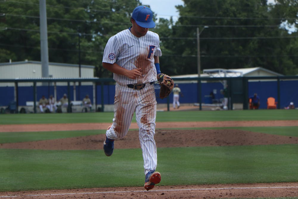 Florida's Nathan Hickey walks towards the dugout Friday against South Florida. The Gators lost 19-1 against South Alabama Saturday to be swept out of their host regional and end their season.