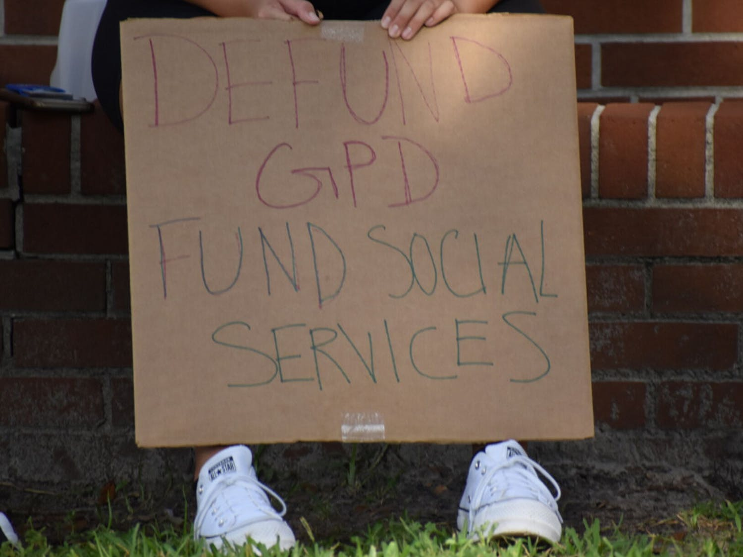 More than 70 people gathered Sept. 3 to protest Gainesville City Commission's proposed increase to GPD's budget.